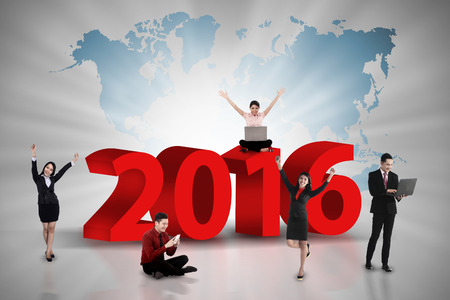 compile: Happy business team work on the year 2016. Business team concept