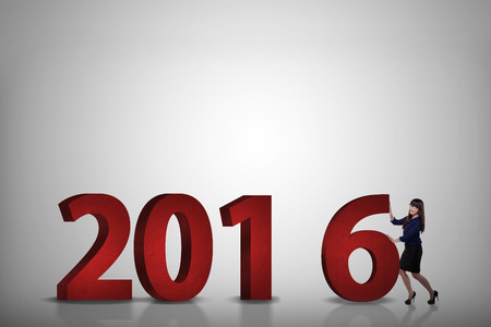 compile: Business person push number 6, so it become 2016. Happy new year concept Stock Photo