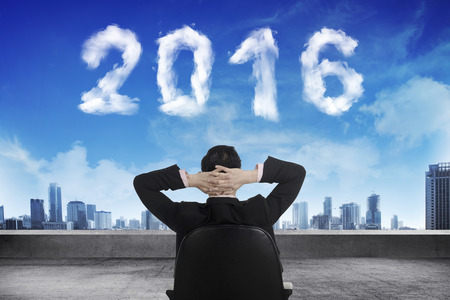 sit shape: Business person sit on chair looking 2016 cloud shape number. New year concept