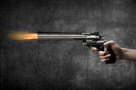 firing: Man hand holding gun and firing it