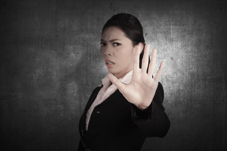 Business person say no with grunge background