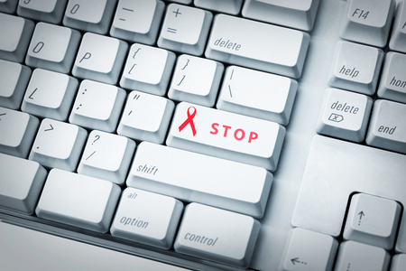 aids awareness: Computer keyboard with red ribbon. AIDS Awareness concept