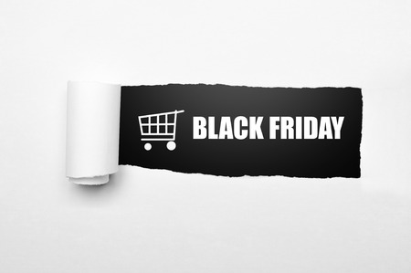 black texture: Shopping cart and black friday text on paper tear. Black friday concept