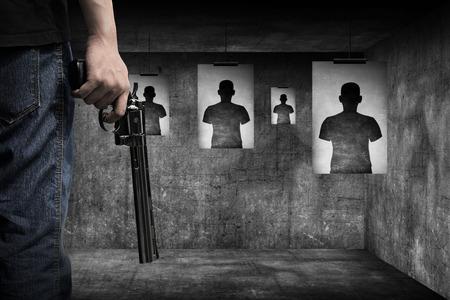 holding gun: Man hand holding gun Stock Photo