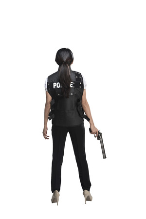 woman behind: Back view of woman holding gun isolated on white background