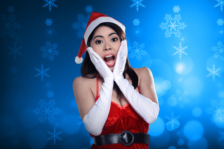 sexy girl: Shocking woman in santa claus costume. Christmas concept Stock Photo