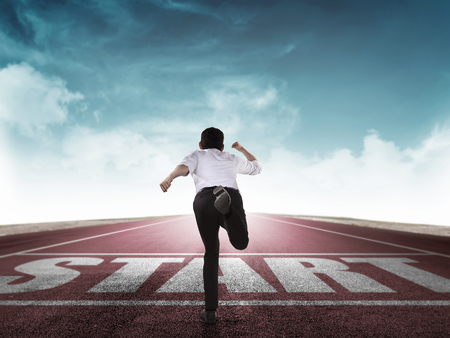 start line: Back view of business man running from start line. Business career concept Stock Photo