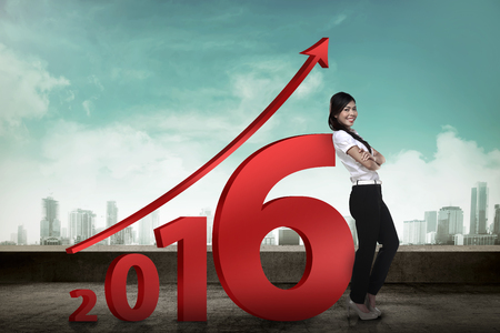 successful business woman: Asian business person lean next to 2016 number. New year resolution concept Stock Photo