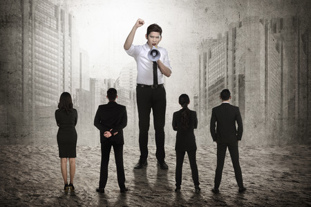 subordinate: Business leader command his subordinate using megaphone. Business leadership concept