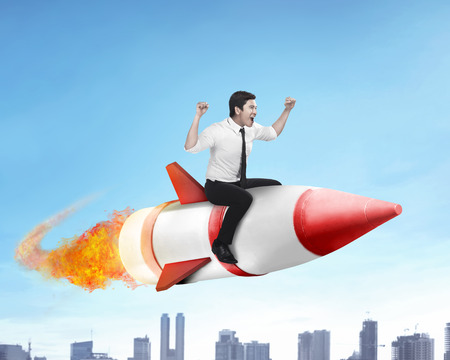 Image of asian business man flying ride rocket