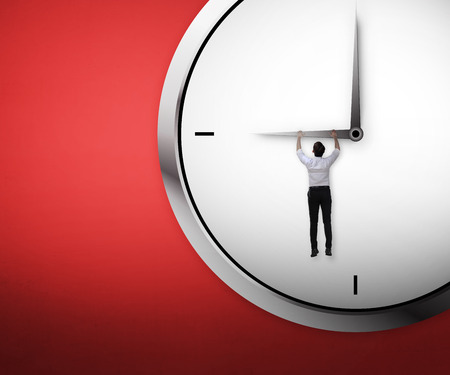 asian business: Asian business man hanging on the clock. Deadline concept