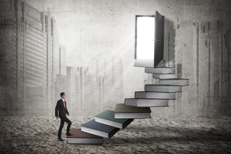 step up: Asian business man step up the stair. Business promotion concept Stock Photo