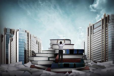 higher education: Asian business man climbing book. Higher education concept
