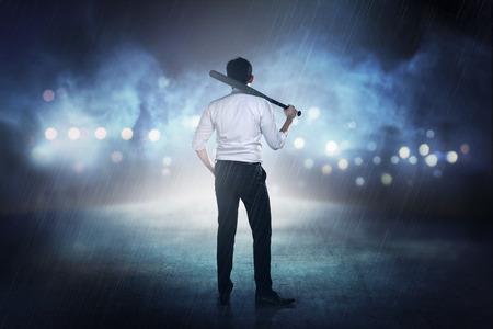 bat: Asian man in white shirt and tie holding baseball bat