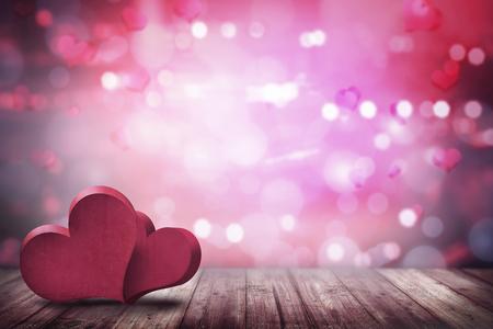 Twee liefde vorm op de houten vloer over wazige achtergrond Stockfoto