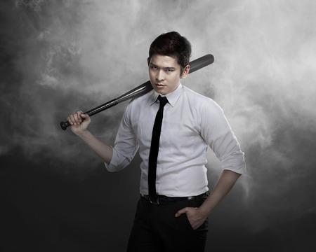 Asian man in white shirt and tie holding baseball bat