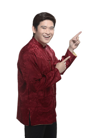 cheongsam: Young chinese man in cheongsam suit isolated over white background