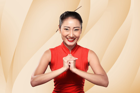 chipao: Chinese woman in cheongsam dress. Happy chinese new year concept