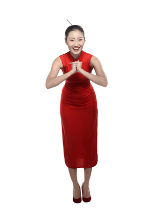 chipao: Chinese girl in cheongsam dress. Happy chinese new year concept