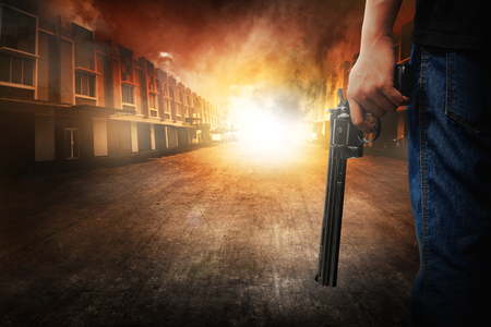 male killer: Man hand holding gun on the residential place