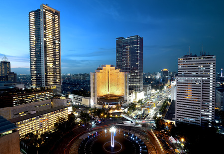 Jakarta city at night with modern building Imagens