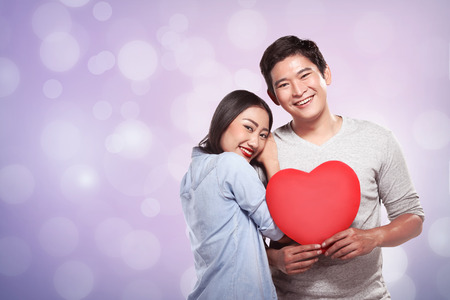 love shape: Lovely couple holding red heart. Valentine day concept