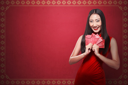chinese lady: Chinese woman in cheongsam dress smile. Happy chinese new year concept