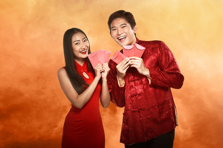 cheongsam: Asian couple in cheongsam suit. Happy chinese new year concept