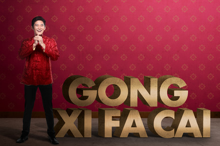 gong xi fa cai: Gong Xi Fa Cai writing and chinese man smiling. Happy chinese new year concept