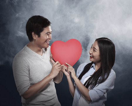 love couple: Lovely couple holding red heart. Valentine day concept
