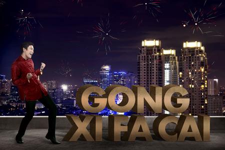gong xi fa cai: Chinese man saying gong xi fa cai. Happy chinese new year concept