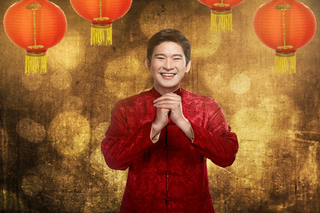 china people: Chinese man smiling. Happy chinese new year concept Stock Photo