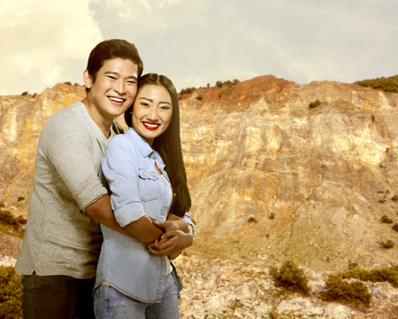 boy and girl holding hands: Asian couple hugging with canyon background. Valentines day concept Stock Photo