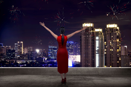 celebrate year: Back view of woman looking the city celebrate chinese new year Stock Photo