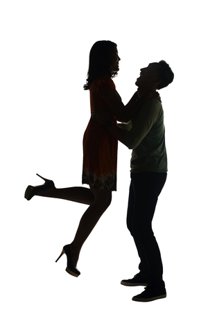boy lady: Silhouette of couple holding hand isolated over white background Stock Photo