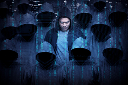 binary background: Hacker wearing hoodie shirt. Security concept image