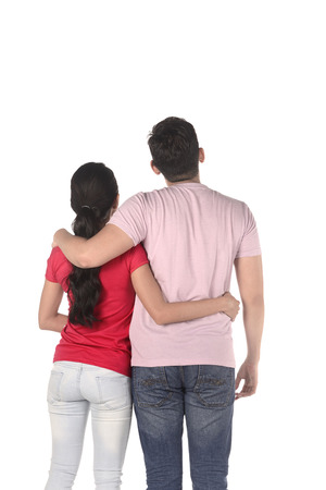 a meeting with a view to marriage: Back view of couple holding hand isolated over white background