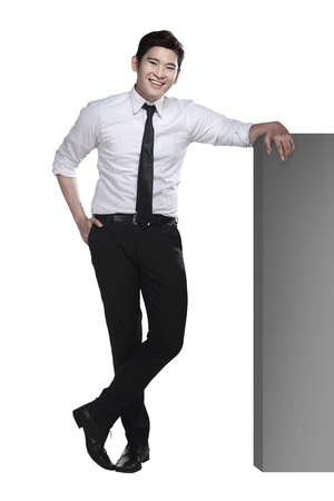 asian man face: Asian business man lean on the block isolated over white background