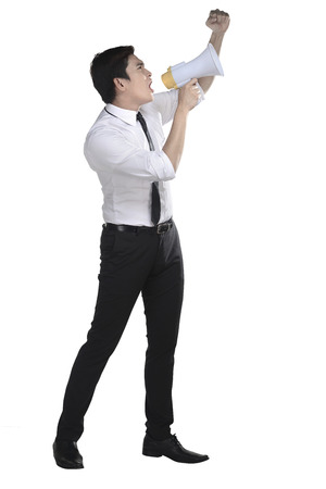 Asian business man shout on megaphone isolated over white background Stock Photo