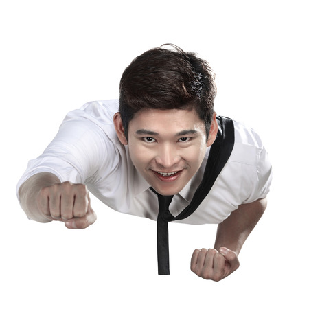 flying man: Asian business man flying isolated over white background Stock Photo