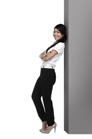 lean over: Asian business woman lean on the block isolated over white background