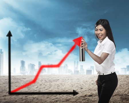 business activity: Asian business person, spray making arrow sketch. Business activity concept