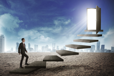 up stair: Asian business person going up to the door using stair. Business career conceptual