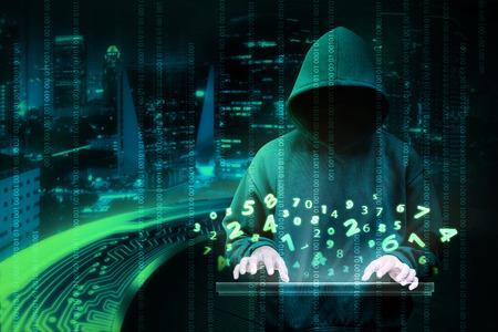 Man in hoodie shirt is hacker. Computer security concept Foto de archivo