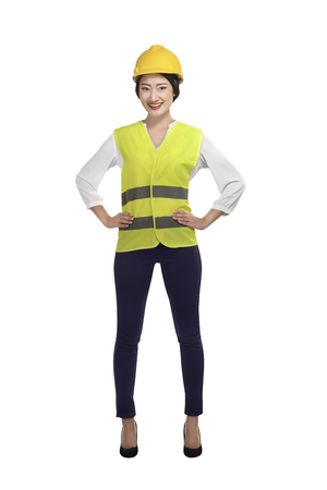 vest in isolated: Asian woman wear had hat and safety vest isolated over white background Stock Photo