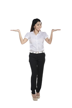 show of hands: Confident asian business woman show something isolated over white background Stock Photo
