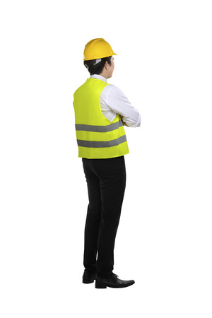 Back view of asian worker wearing safety vest and yellow helmet isolated over white background Reklamní fotografie
