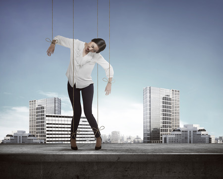 marionette: Asian business woman hace string attached on her body like marionette. Business manipulated concept Stock Photo