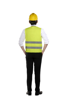 helmet: Back view of asian worker wearing safety vest and yellow helmet isolated over white background Stock Photo