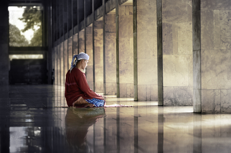 Religious muslim man praying inside the mosque Stock Photo